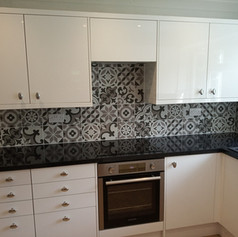 Kitchen with patterned grey tiles