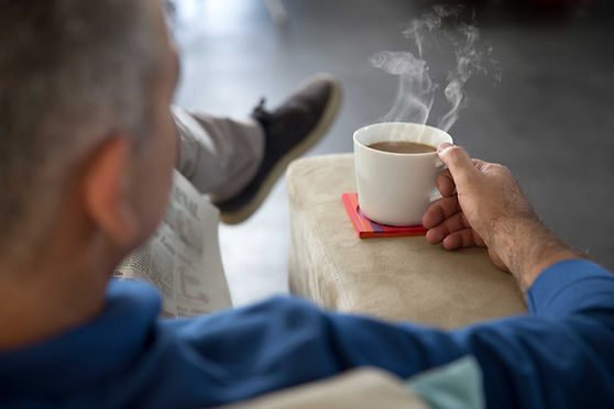 Man with hot cup of tea