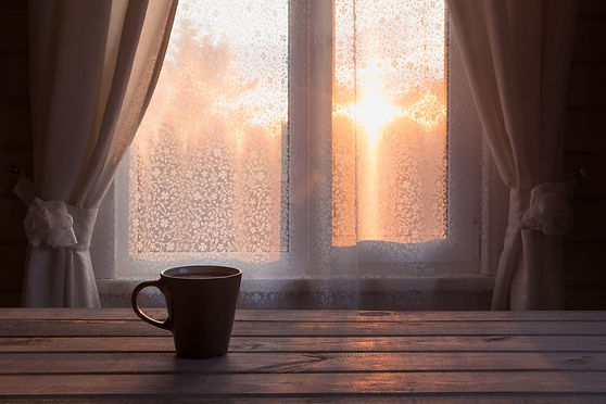 Cup of tea on window sill