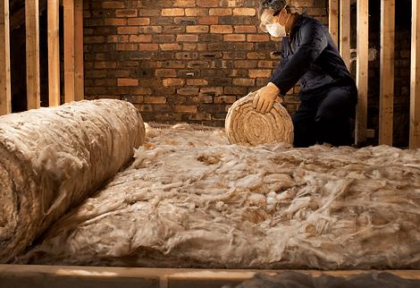 Worker laying loft insulation