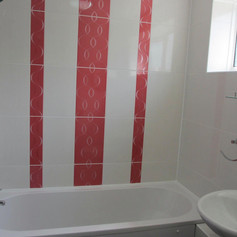 Bathroom with white and red tiles