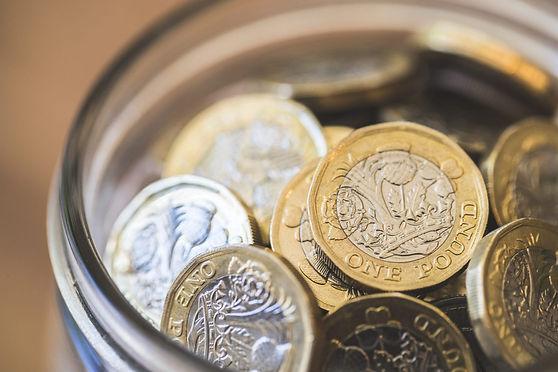 Pound coins in a jar