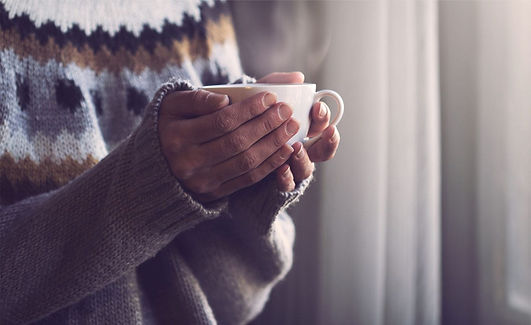 Woman holding hot drink