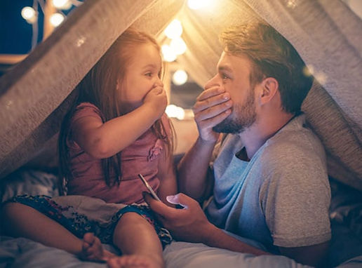 Father and daughter in blanket fort