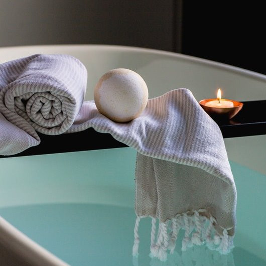 relaxing bath with towel and candle