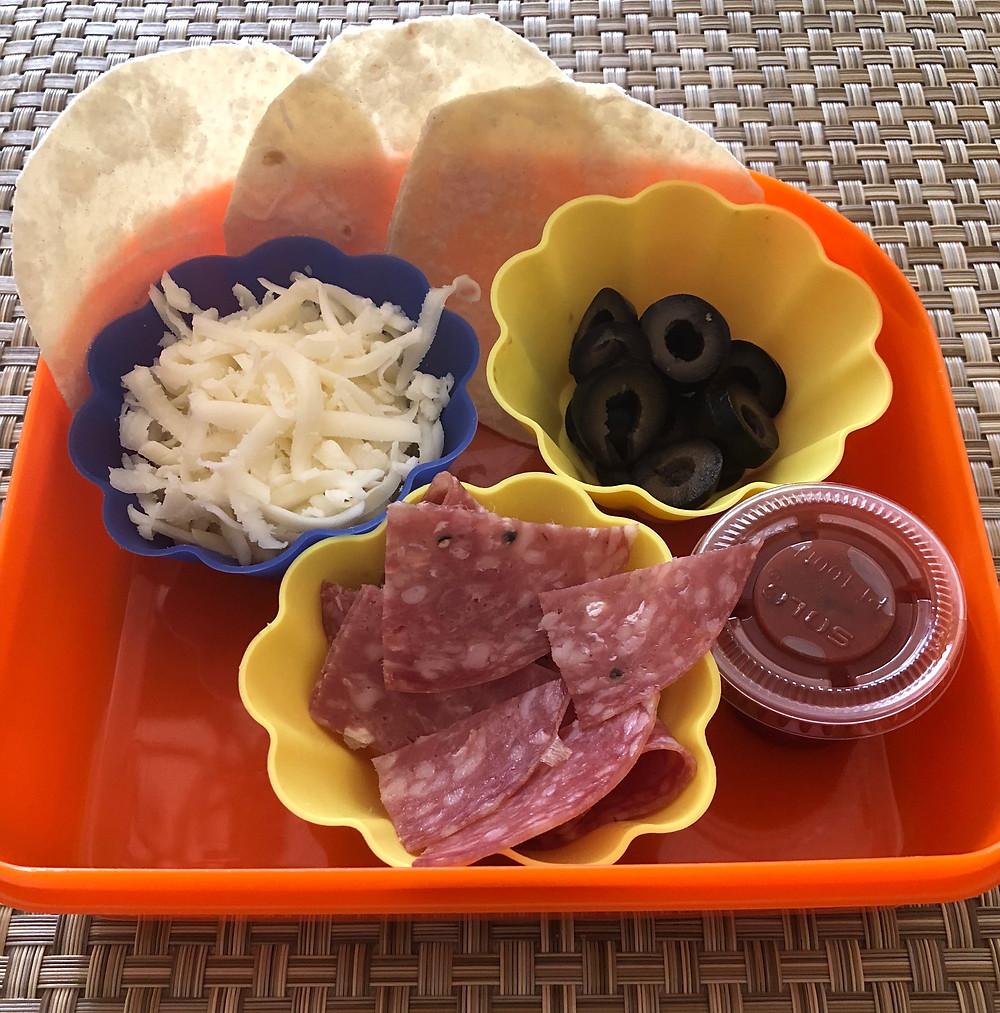 low carb healthy fat build your own pizza lunch tortilla circles mozzarella black olives salami marinara