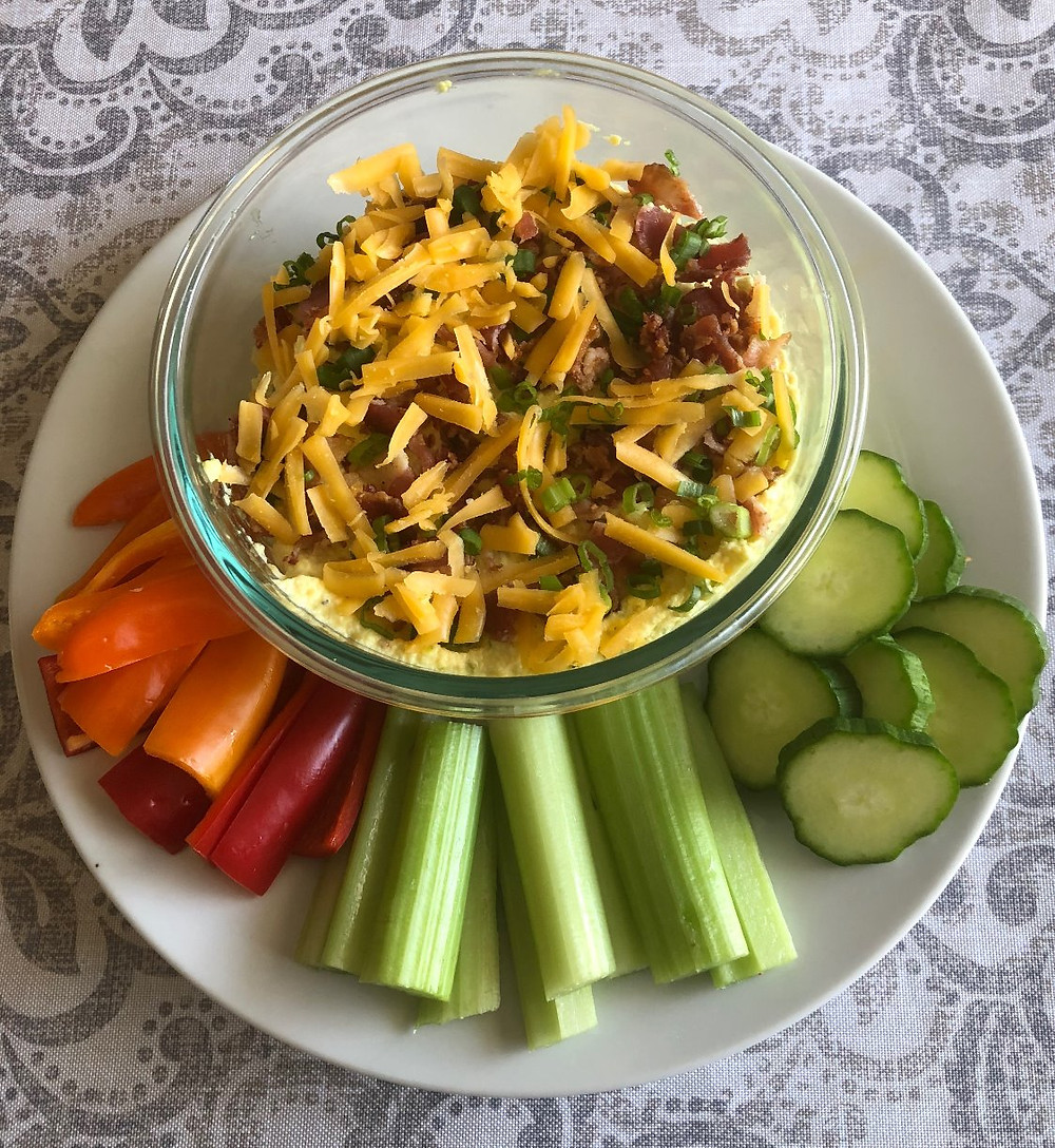 low carb keto diabetic friendly game day bacon cheddar deviled egg dip with celery cucumber bell peppers