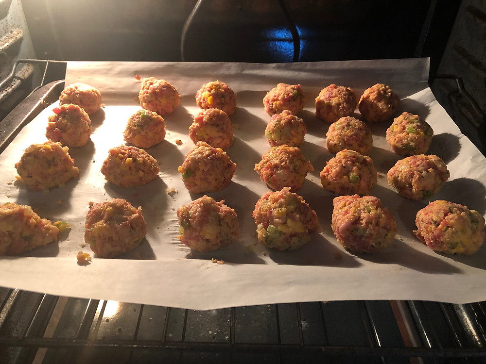 low carb sausage stuffing balls on a sheet pan in the oven Thanksgiving Christmas holiday side dish appetizer