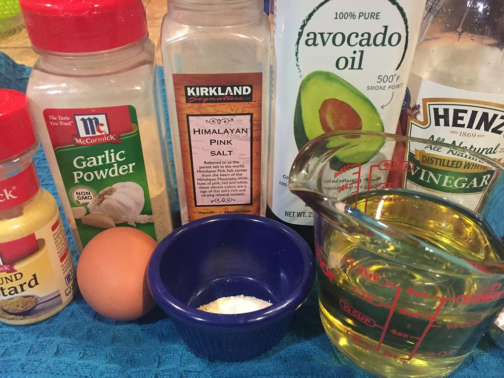 Ingredients for mayonnaise egg mustard garlic powder Himalayan pink salt white vinegar avocado oil