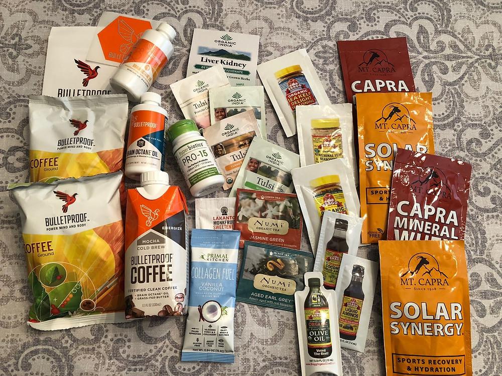 Bulletproof coffee, Numi Tea, MCT oil, Primal Kitchen Collagen, Organic India, Braggs, Capra on a table