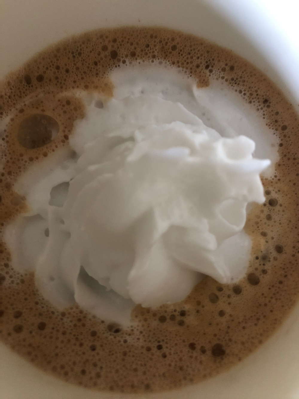 low carb keto sugar free peppermint mocha with whipped cream in a white mug