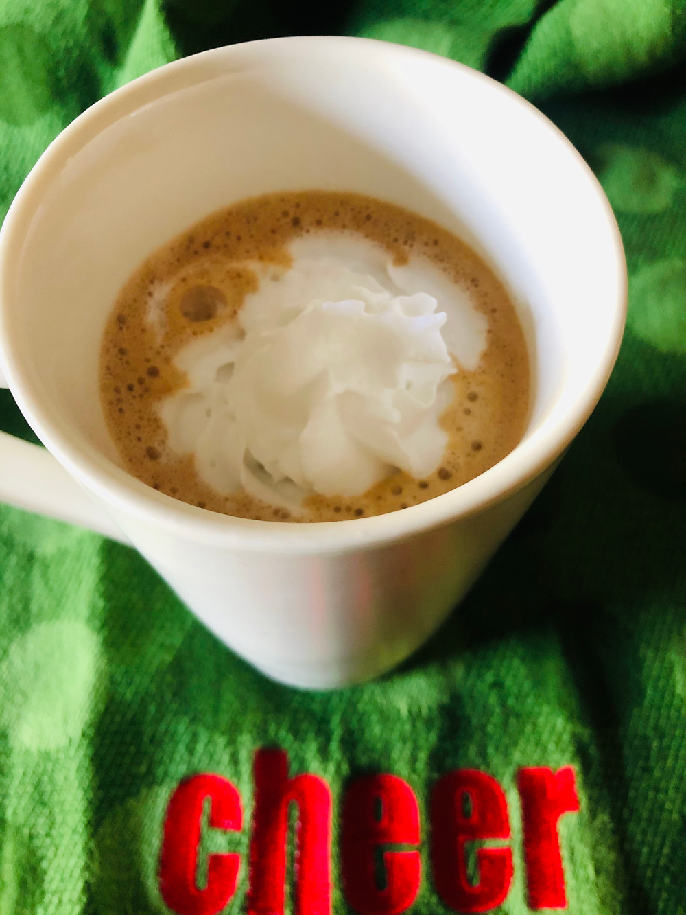peppermint mocha whipped cream in a white mug keto low carb sugar free