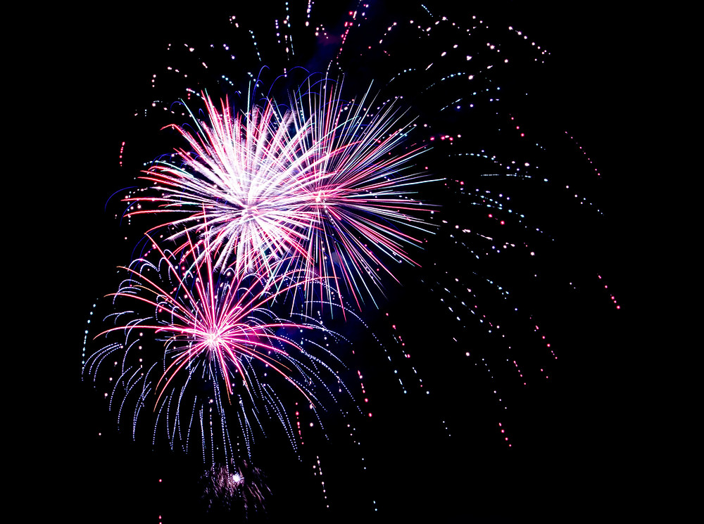 Red, white, and blue fireworks cluster