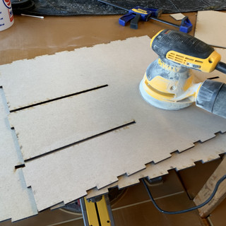 Sanding the pieces for the drawers