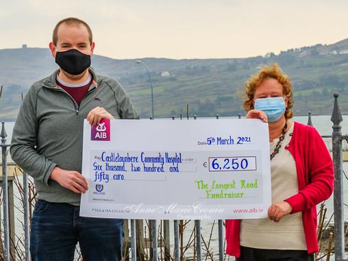 The Longest Road Fundraiser by Garnish Gaa cheque presentation