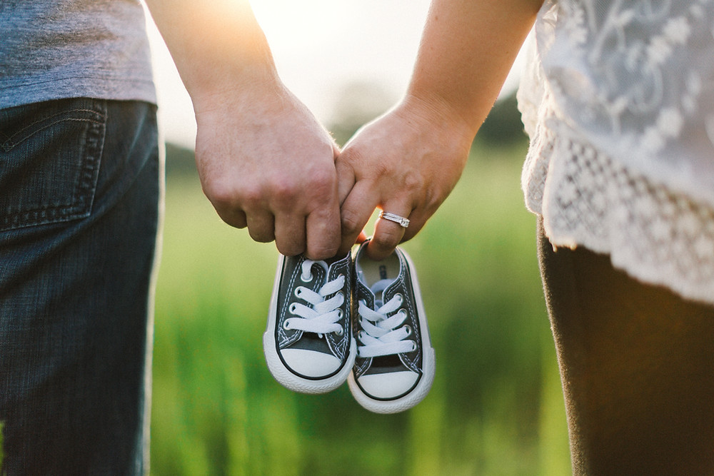 Couple with baby sneakers