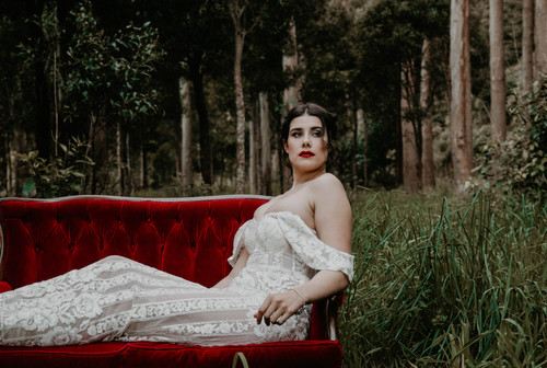 Vintage Halloween inspired wedding styled shoot, Bride in Trish Peng dress in vintage Victorian red velvet couch.