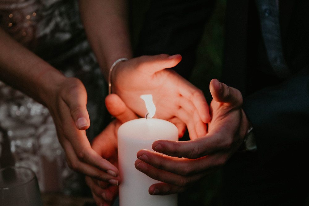 Vintage Halloween inspired wedding styled shoot, couple surrounding candle.