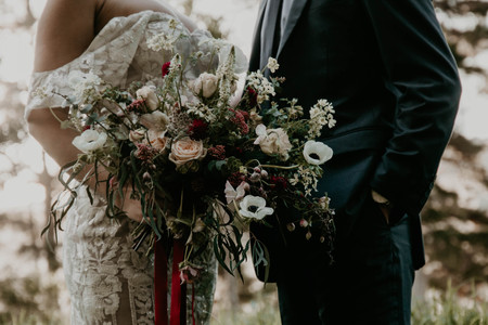 Vintage Halloween inspired wedding styled shoot, moody wedding bouquet held by bride.