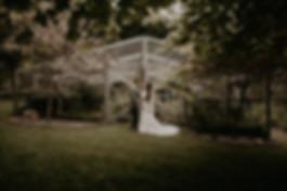 Gorgeous oudoor wedding in Wellington new zealand in front of greenhouse
