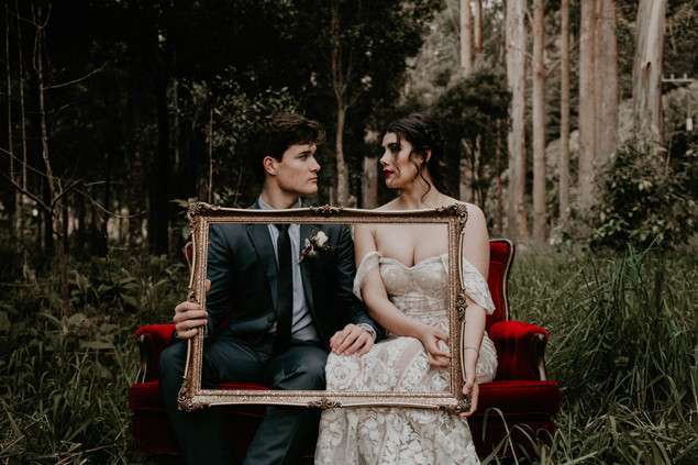Vintage Halloween inspired wedding styled shoot, vintage couch and frame decor in forest..