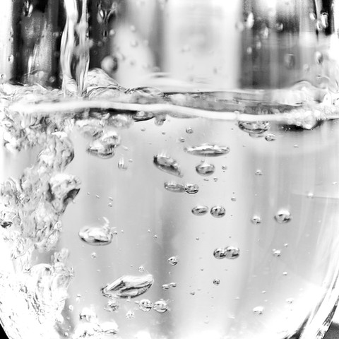A Glass Of White Wine - Bubbles From A Serving Of Wine