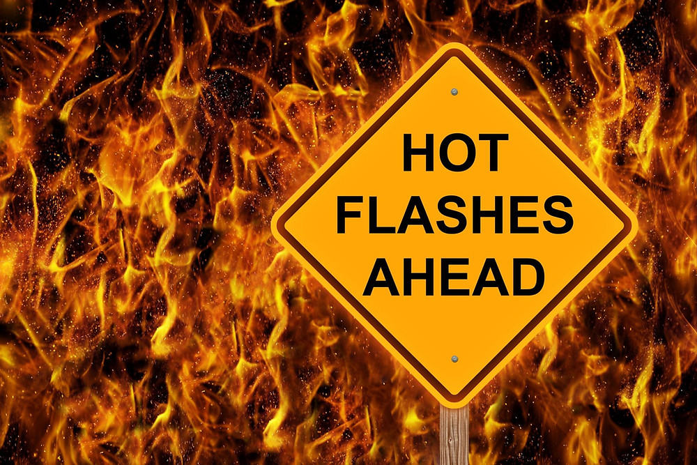 Hot flashes (flushes) sign in front of flames