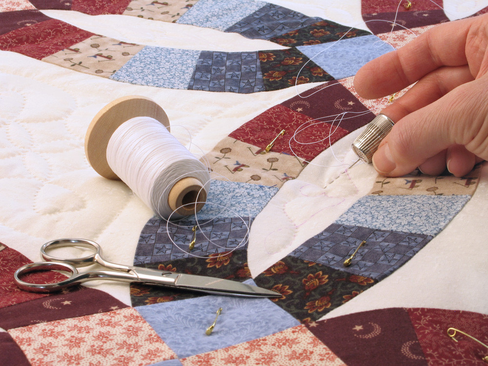 Close-up photo of the craft of quilting, enjoyed by Mary Lou Lange