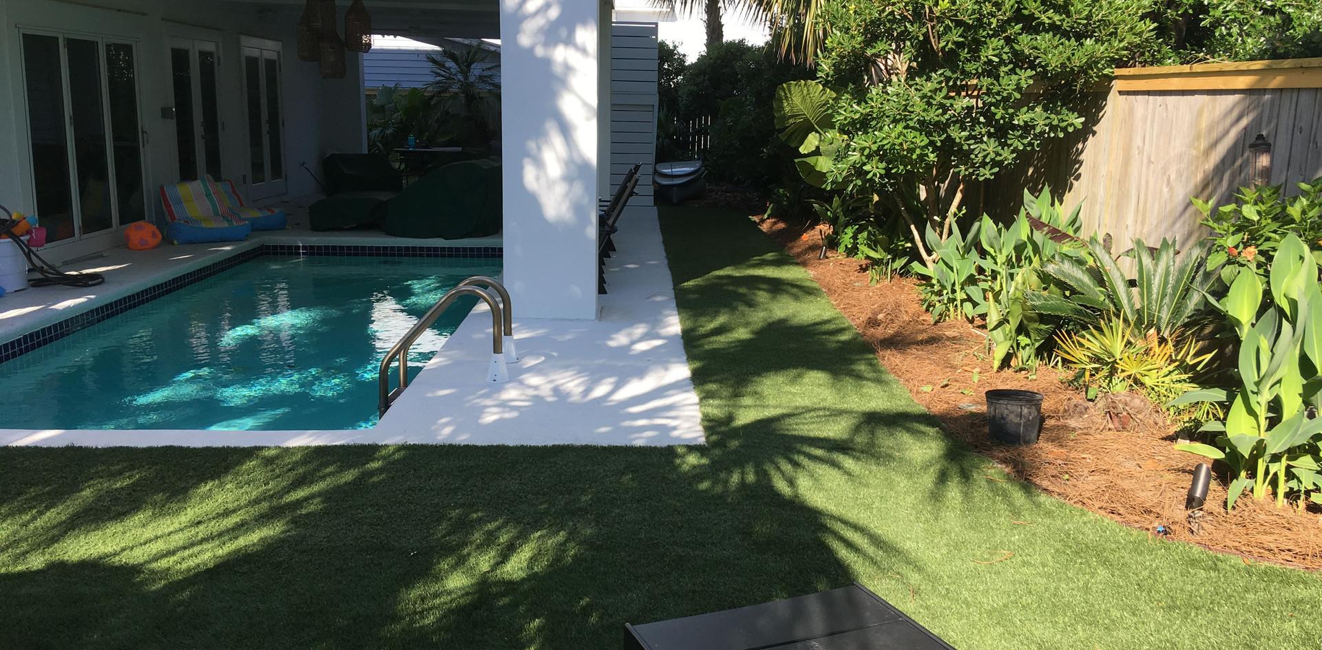 turf around under deck pool area.jpg