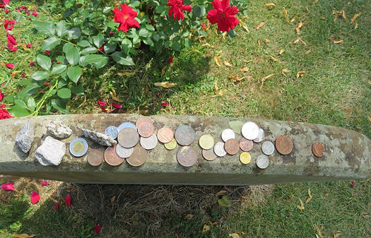 COINS ATOP THE GRAVESTONE.jpg