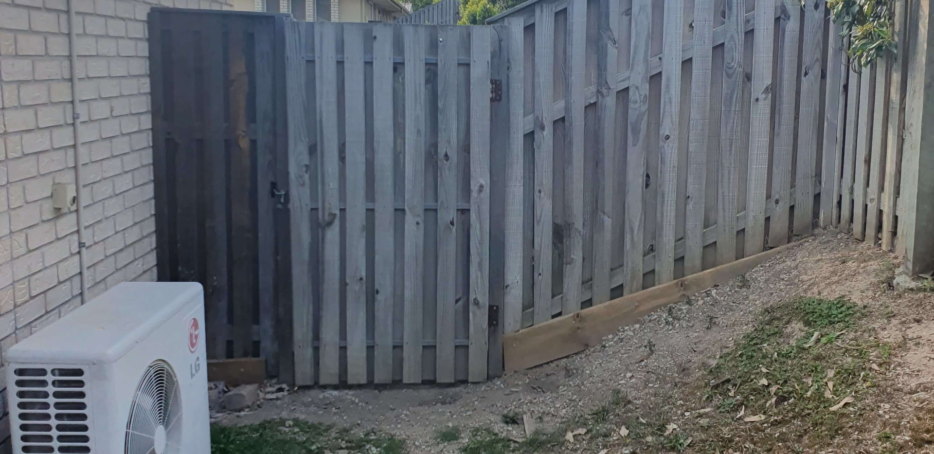 Side access fencing & gate (before)