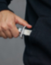 bandit pulls out his pocket folding knif