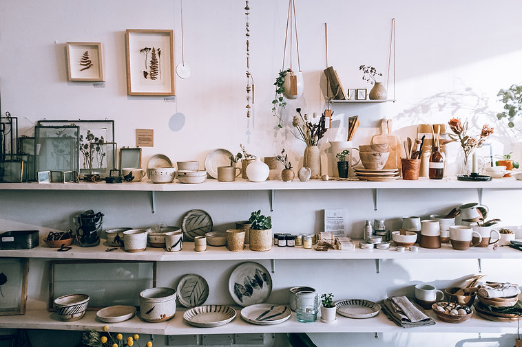 assorted-ceramics-on-wooden-shelves-3626