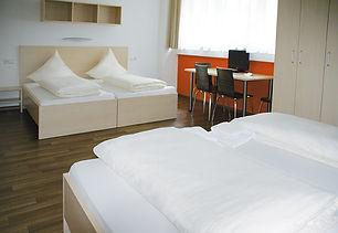 Orange_Vierbettzimmer_2.jpg
