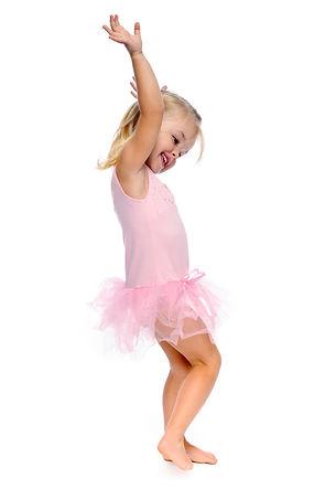 young girl dances ballet in her ballerin