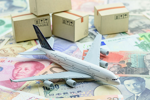 White model airplane lands on banknotes