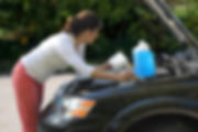 Lady-checking-fluids-938x535.jpg
