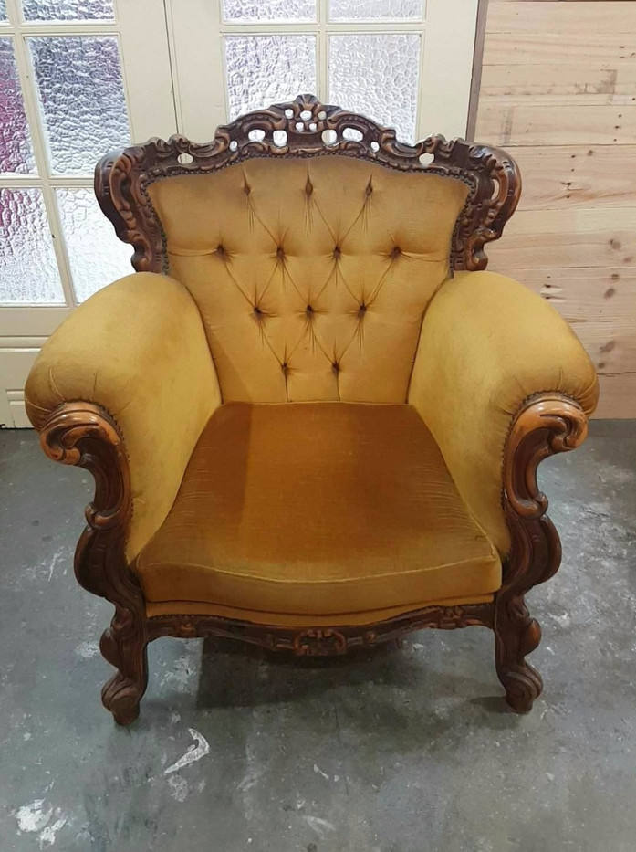 A pair of gold armchairs