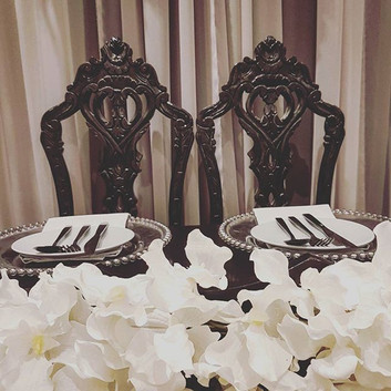 Black pair of ornate chairs