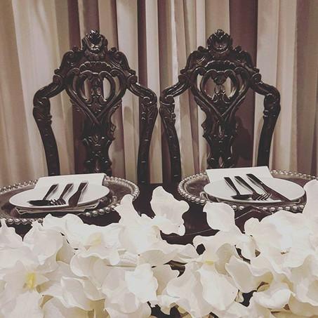 Black pair of ornate chairs