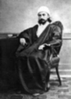 Retrato fotográfico de 'Abdu'l-Bahá em sua juventude