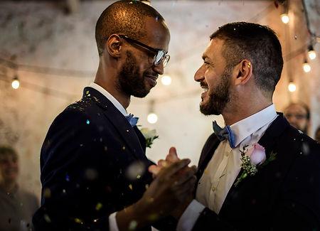 closeup-newlywed-gay-couple-dancing-wedd
