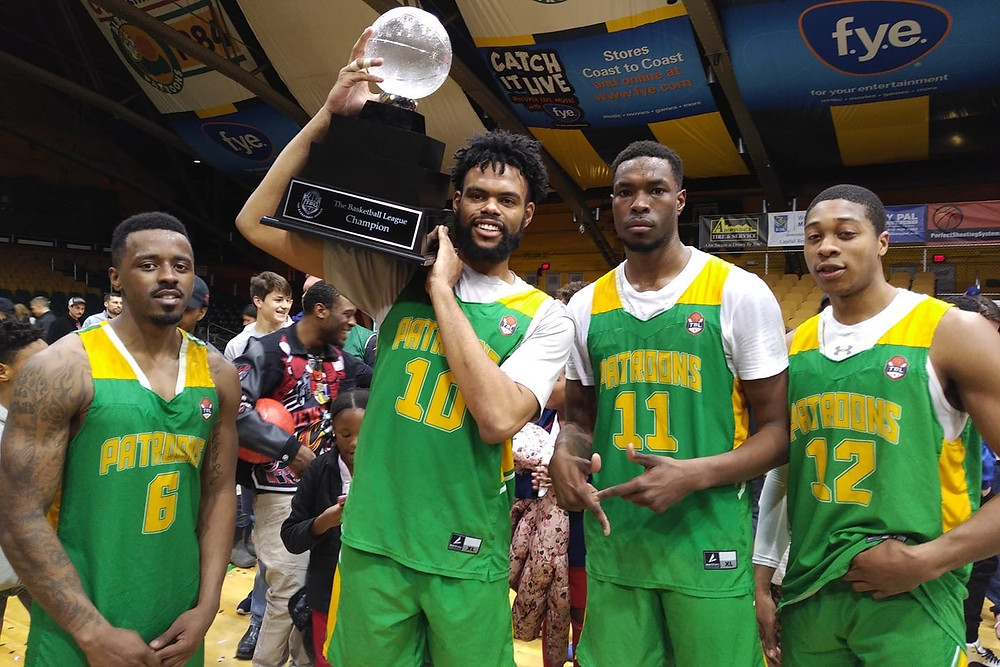 Members of the Patroons holding the trophy after winning the 2019 TBL championship
