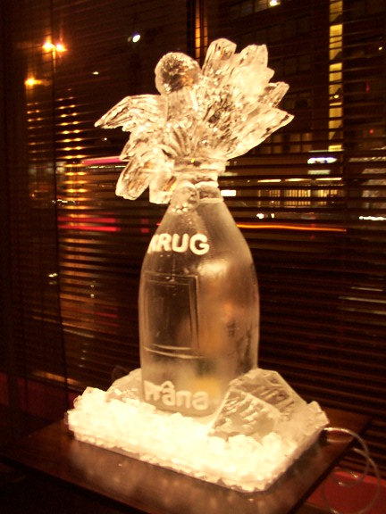 Price Code E A wedding is the ultimate celebration and champagne is the best iconic symbol of celebration. We can freeze in a label of choice and alter the wording the read that of the couples choice if required. Most wedding sculptures can also be ice luges. All Wedding Ice sculptures are carved to order.  Size 1m x 50cm  Delivery, light pack and drain tray included anywhere England or Wales. For prices further ideas and details please call Alan 0800 999 6555 We also supply Ice Cubes, crushed ice, ice shot glasses and chilled vodka - just add to the order and we'll take care of it.
