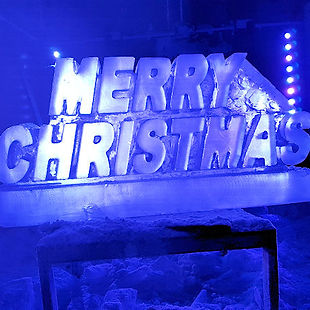 Christmas Vodka Ice Luge supplied with drain tray,lighting andFree Delivery throughout England and Wales.