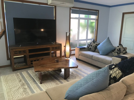 Lounge in Style with Large Flat Screen TV