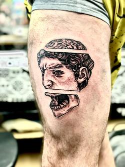 David Michelangelo skull tattoo