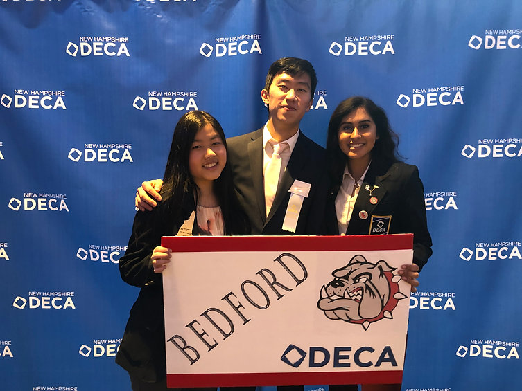 Daniel with 2 friends at DECA states