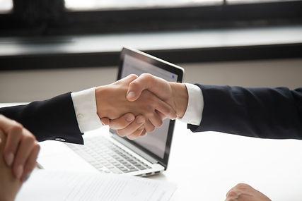 businessman-handshaking-businesswoman-sh