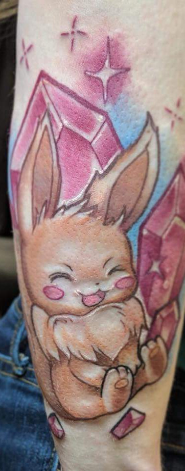 Eevee and crystal tattoo by Amy Porter